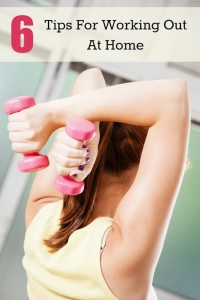 Beautiful Young Woman Exercising At Home With Dumbbells